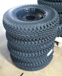 skid steer winter tires in manitoba winnipeg promac stack