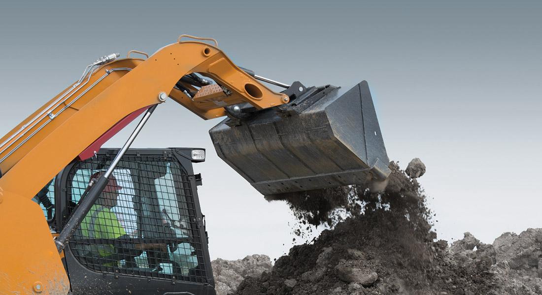 bucket skid steer dumping gravel