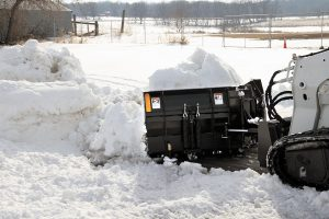 skid steer with v plow blade attachment