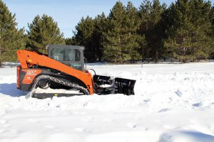 skid steer with v plow blade attachment side